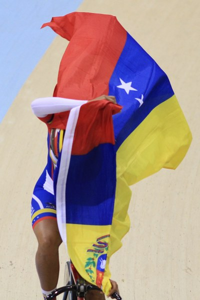 A Venezuelan rider struggles to open her flag. Photo: Vasilios Devletoglou
