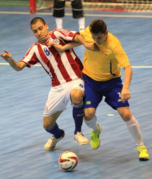 Paraguay take on Brazil in futsal.