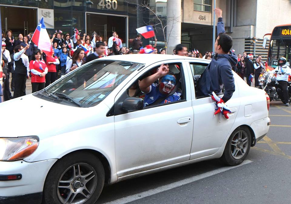 A La U fan celebrates Chile's victory. Photo: Vasilios Devletoglou