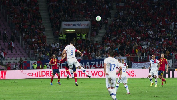 Marcos González takes to the air against Spain. Photo: Clément Bucco-Lechat/Wikicommons